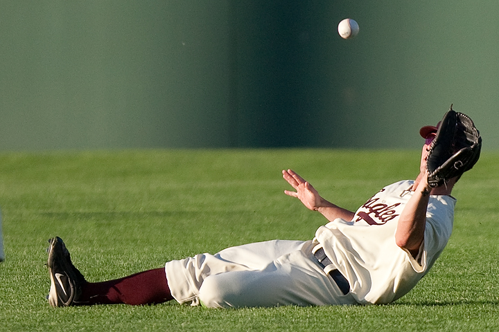The Souix Falls Canaries right fielder slides to make a catch during a game against the Saint Paul Saints on June 23, 2009. The Saints won the game 12-3.