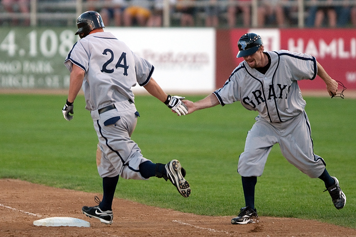 St. Paul Saints outfielder Jacob Butler celebrates with first-base coach Charlie Ruud after Butler hit his second of two home runs of the inning as part of an 11-run bottom-of-the-sixth for the Saints. The Saints beat the Sioux Falls Canaries 12-3, in part due to Butlers 5 RBI, on June 23 at Midway Stadium in Saint Paul. In celebration of Minnesota?s history in the Negro Leagues, both teams donned uniforms of past Negro League teams. The Saints wore the uniform of the Homestead (Penn.) Grays while the Canaries donned the uniform of the Newark (N.J.) Eagles.