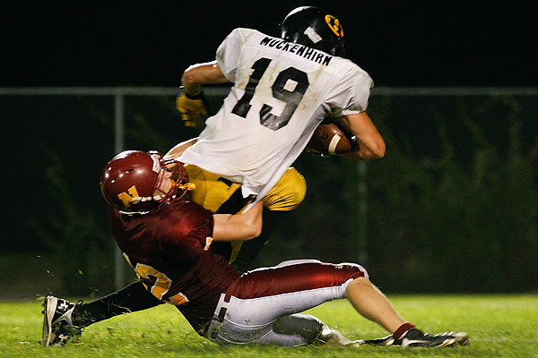 Northfield's Ben Truax tackles Hutchinson's Brad Muckenhirn during a 19-14 Hutchinson victory on Sept. 18, 2009 in Northfield, Minn.