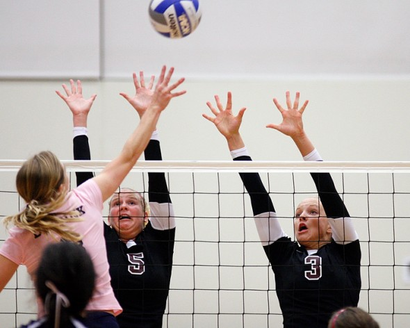 Augsburg volleyball players Korri Yule (5) and Katie Christensen (3).