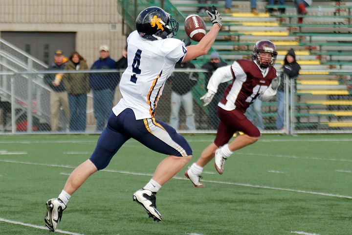 Carleton WR Erik Fabry hauls in a 50-yard touchdown pass from Vaughn Schmid in the first quarter of a game between Augsburg College and Carleton College on October 10, 2009 in Minneapolis, Minn. Augsburg won 31-28. Fabry had 5 catches for 70 yards.