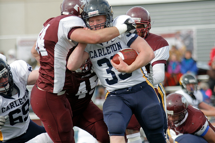 Augsburg's Alex Glasenapp tackles Carleton's Phil Blue during a game between Augsburg College and Carleton College on October 10, 2009 in Minneapolis, Minn. Augsburg won 28-15. Glasenapp had 7 tackles while Blue had 25 yards on 4 carries.