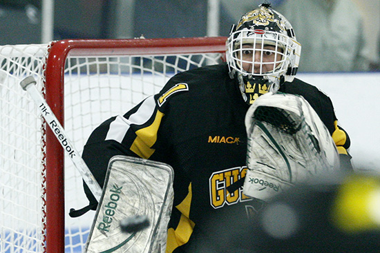 Gustavus goaltender John McLean (FY, Eagan, Minn.) watches a shot on goal during a game between the Gusties and Augsburg on December 3, 2011 in Minneapolis. McLean collected 36 saves in the 4-1 victory over the Auggies.