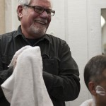 Craig Martin shares a laugh with a client at Mug & Brush Hair Design in South Minneapolis, Minn. on January 3, 2012.
