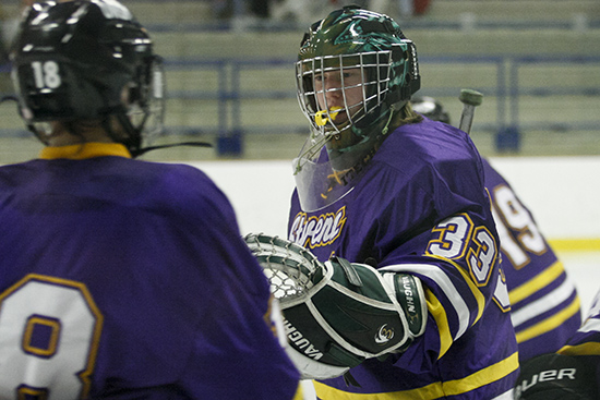 January 10, 2012, Mendota Heights, Minn. -- University of Wisconsin-Stevens Point goaltender Johanna Sommers (left) congratulates Nicole Schaub after a goal scored by Brooke Hanson (19) during a non-conference game between the University of St. Thomas and the University of Wisconsin-Stevens Point. St. Thomas won 3-1.