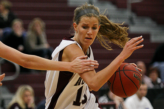 MINNEAPOLIS -- Augsburg women's basketball player Brittany Dyshaw drives the lane during the first half of a 61-51 victory over visiting St. Olaf College on January 11, 2012. Dyshaw scored nine points and collected four steals.