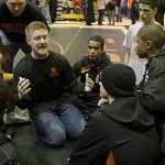 MINNEAPOLIS -- Members of the Minneapolis South High School varsity wrestling team gather around assistant coach Joe Morgan (kneeling) following a 52-28 dual meet loss to Waconia High School on January 12, 2012 at South.