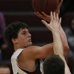MINNEAPOLIS -- Augsburg basketball player Andy Grzesiak-Grimm takes a shot in the second half of a 73-63 loss to conference co-leader Gustavus Adolphus. Grzesiak-Grimm scored 20 points and pulled down 11.