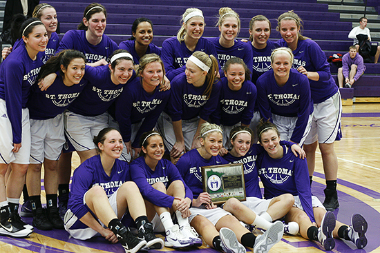 ST. PAUL, MINN. -- Members of the No. 15 University of St. Thomas women's basketball team pose for photographer Greg Smith after claiming a share of the MIAC regular season conference championship with a 93-52 victory of St. Catherine University on Feb. 8, 2012 in St. Thomas' Shoenecker Arena.