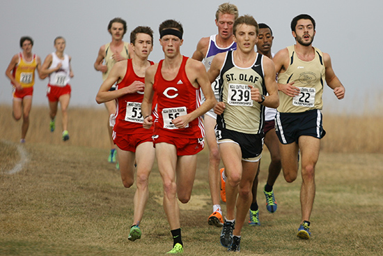 Zach Haskins (22) keeps pace with the lead pack near the 5,250 meter mark.
