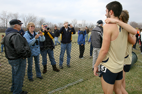 Zach Haskins, left, and Matt Berens pose for photos after the race.