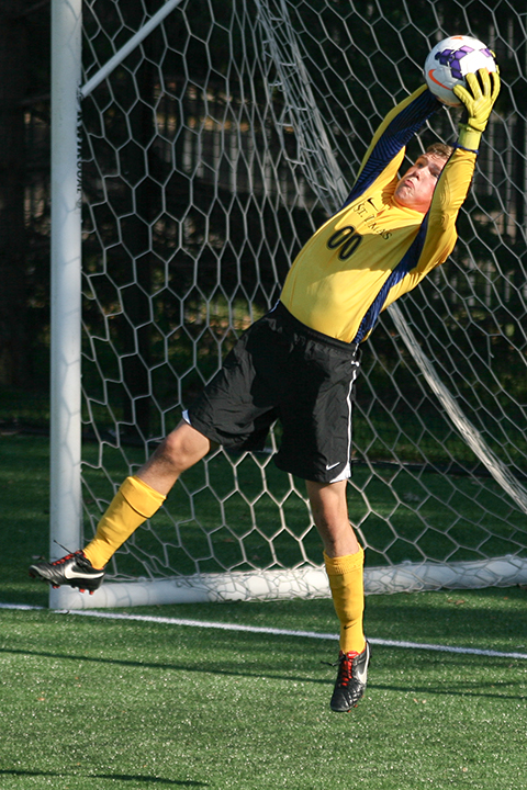 University of St. Thomas men's soccer goalkeeper Ryan Holte extends to make a save during the second half of a 3-0 victory over visiting Dubuque University.