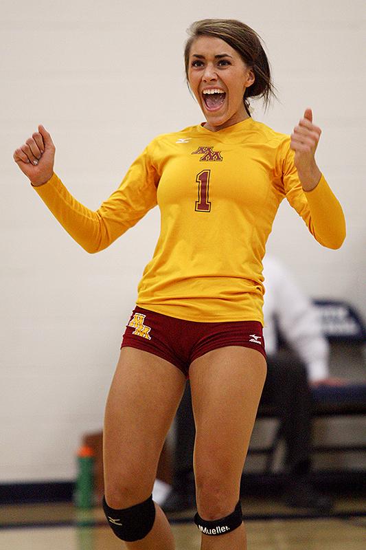 Minnesota Morris volleyball player Brooke Decker celebrates during a match at North Central (Minn.). Decker's Cougars won 3-0.