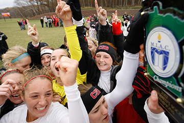 COLLEGEVILLE, MINN. -- The St. Benedict (Minn.) women's soccer team celebrates after winning the 2013 MIAC playoff title game via a 3-2 victory over Macalester in the MIAC women's soccer playoff final at St. John's Univ. (Minn.) Hawes Field, Nov. 9, 2013.