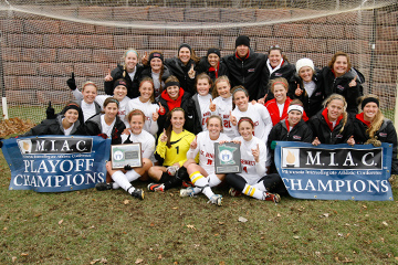 COLLEGEVILLE, MINN. -- The St. Benedict (Minn.) women's soccer team poses after winning the 2013 MIAC playoff title game via a 3-2 victory over Macalester in the MIAC women's soccer playoff final at St. John's Univ. (Minn.) Hawes Field, Nov. 9, 2013.
