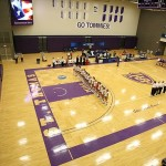 """ST. PAUL, MINN. (Nov. 14, 2013) -- The College of St. Benedict and Cornell College volleyball teams during the playing of the """"National Anthem"""" before an NCAA Div. III Women's Volleyball Regional game at the University of St. Thomas. St. Benedict went on to defeat Cornell 3-0."""