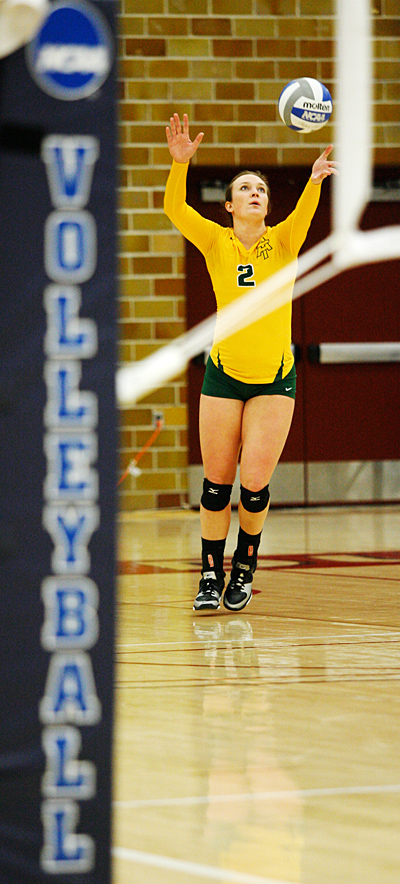 DULUTH, MINN (Dec. 5, 2013) -- Arkansas Tech Outside Hitter Emily Todd (2) sets the ball during the second set of a 2013 NCAA Division II Volleyball Championships First Round match between host Minnesota, Duluth and Arkansas Tech University at the Romano Gym. UMD swept ATU 3-0.