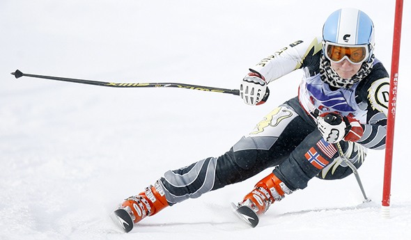 St. Olaf's McKenna McNabb clears the final gate during her second Giant Slalom run, finishing in first in 29.19 seconds during a USCSA Midwest Conference Lake Superior Division event at Giants Ridge in Biwabik, Minnesota on January 26, 2014.