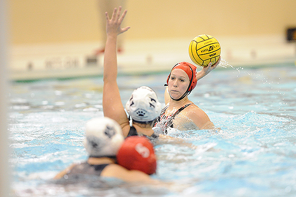 ST. PAUL, MINN. (April 12, 2014) -- Washington & Jefferson water polo player Rachel Clauss looks to pass over Penn State Behrend's Mary Therese Causgrove during the Collegiate Water Polo Championships at Macalester College.