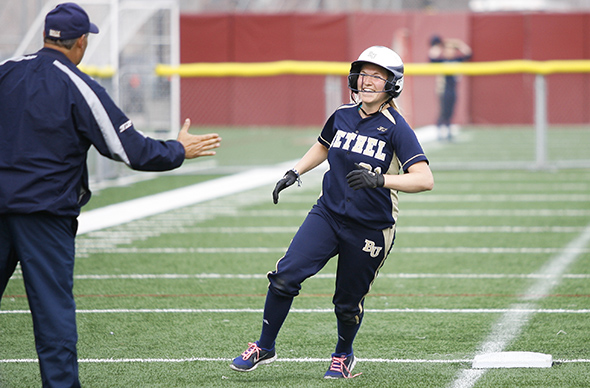 Bethel University sophomore Micayla Moore (Hutchinson, Minn. / Hutchinson) celebrates her second inning home run to put the Royals 1-0 over St. Benedict's in the loser's bracket game in the MIAC playoffs on Friday, May 1, 2014. Bethel later won the game 10-6.
