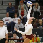 Augsburg volleyball player Colleen Ourada (6) hits the ball in the fourth set of a match between UW-Stout on September 11, 2014. Augsburg won 3-2 (25-12, 15-25, 25-18, 18-25, 15-9). Ourada had 14 kills.