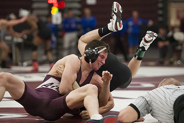 Augsburg's Chad Bartschenfeld (left) grapples with St. John's Evan Guffey in their 133 pound third-place match at the 2015 NCAA Div. III Wrestling West Regional at Augsburg College's Si Melby Hall on Feb. 28, 2015. Bartschenfeld won the match 6-0 to qualify for the National Championships on March 14-15.