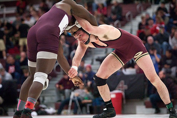 Sebastian Gardner (Concordia-Moorhead) ties up with Tyrell Martin (Augsburg) during their 174 pound first-place match at the 2015 NCAA Div. III Wrestling West Regional on Feb. 28, 2015 at Augsburg College's Si Melby Hall. Third-seeded Martin upset top-seeded Gardner 5-4 on a last-second takedown.