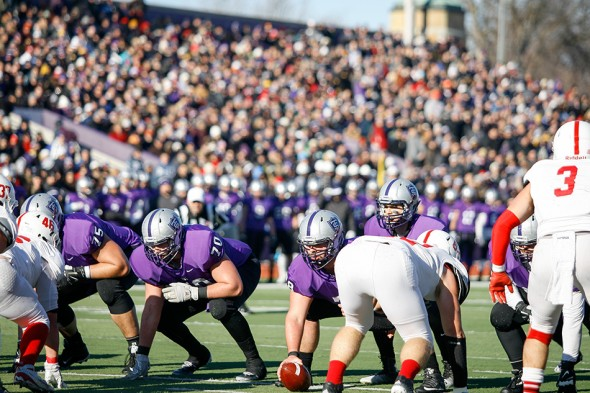 ST. PAUL, MINN. (Nov. 28, 2015) -- The St. Thomas offensive line prepares for a play in front of a crowd of 8,025 fans at St. Thomas' O'Shaughnessy Stadium during the first quarter of an NCAA Div. III Football second round playoff game in St. Paul, Minn. The No. 4 Tommies defeated their arch-rival No. 10 Johnnies 38-19. On this drive, the Tommies failed to convert a turnover in Johnnie territory into any points after a failed field goal attempt.
