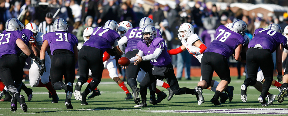 ST. PAUL, MINN. (Nov. 28, 2015) --  St. Thomas quarterback John Gould (17) pitches the ball to junior running back Jordan Roberts (23) during the second quarter of an NCAA Div. III Football second round playoff game at the University of St. Thomas in St. Paul, Minn. The No. 4 Tommies defeated their arch-rival No. 10 Johnnies 38-19.