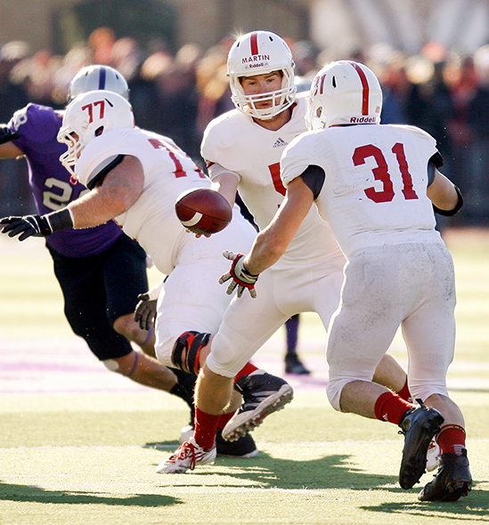 ST. PAUL, MINN. (Nov. 28, 2015) -- St. John's senior quarterback Nick Martin (5) hands the ball off to senior running back Sam Sura (31) during the third quarter of an NCAA Div. III Football second round playoff game at the University of St. Thomas in St. Paul, Minn. The No. 4 Tommies defeated their arch-rival No. 10 Johnnies 38-19. Sura rushed for 54 yards and a touchdown in his final collegiate game.